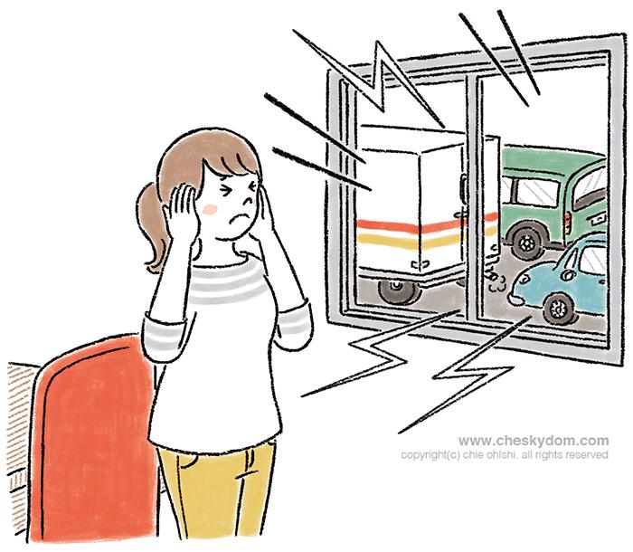 窓の外の騒音がうるさくて仕事ができない女性のイラスト